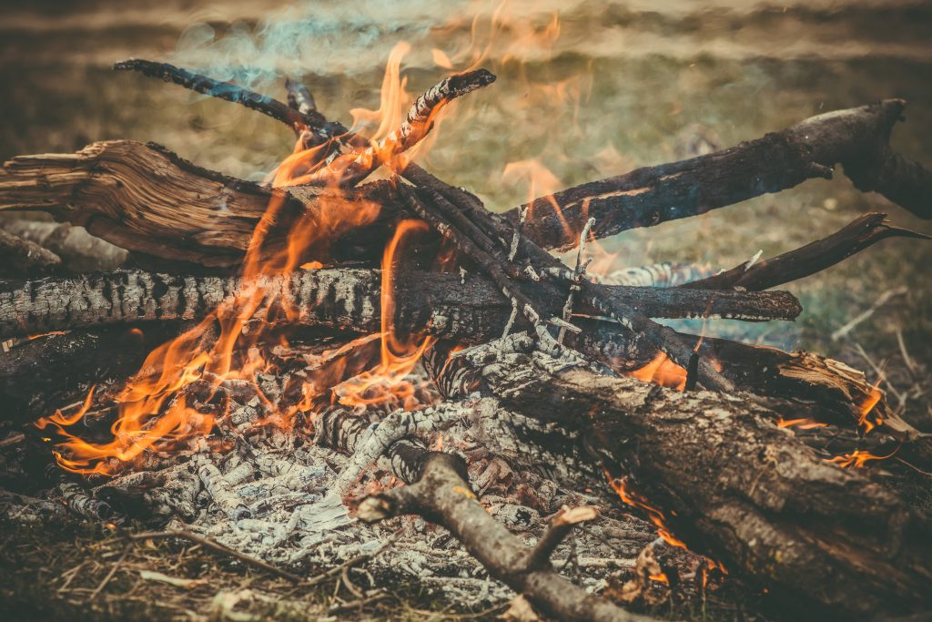 Fire Flame wooden camp burning Outdoor travel vacations concept moody background