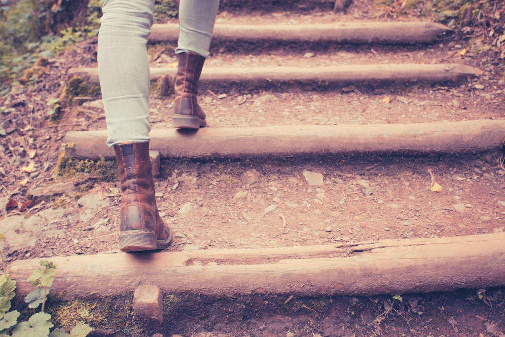 Close up on a young woman's legs as she is walking in nature